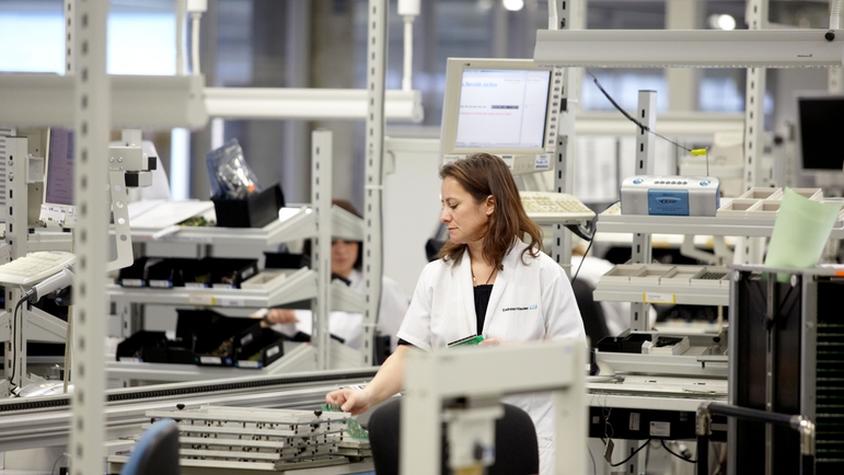 Production competencies, woman with printed circuit boards