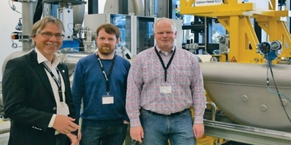 Picture of customers Wintershall in front of hydrocarbon calibration rig at Endress+Hauser Flow